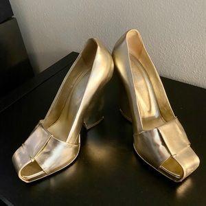 YSL gold pumps